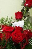 Red roses. With handwritten sign saying sorry Stock Photos
