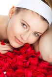 Red roses. Young woman and red roses in her hands Stock Images