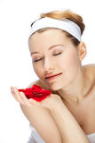 Red roses. Young woman and red roses in her hands Stock Photo