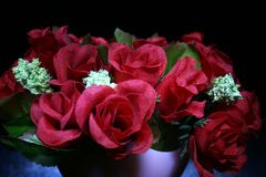 Red Roses. A bouquet of artificial red roses royalty free stock photos