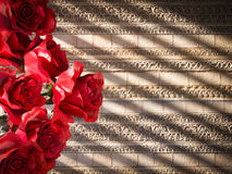 red roses on ancient wall decorative background Royalty Free Stock Image