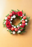 Red roses and apples in a wreath Stock Photos