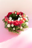 Red roses and apples in a wreath Royalty Free Stock Images