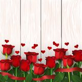 Red roses background. Red roses on wooden background. Greeting card for Valentine`s day, women`s day, mother`s day, birthday. Top view with space for your text Stock Photography
