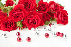 Red roses and beads Royalty Free Stock Photos