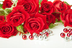 Red roses and beads royalty free stock image