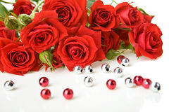 Red roses and beads Royalty Free Stock Images