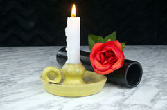 Red roses with black vase, candle on the marble table Royalty Free Stock Photography