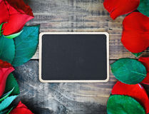 Red roses and blackboard Royalty Free Stock Photography