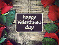 Red roses and blackboard Royalty Free Stock Images