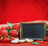 Red roses and blackboard with space for text Royalty Free Stock Image