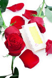Red roses with a blank gift card. On a white background Royalty Free Stock Images