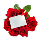 Red roses bouquet with blank paper note on white. Red roses bouquet with blank paper note isolated on white background Royalty Free Stock Images