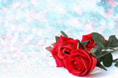 Red roses bouquet with blue bokeh and free space for valentine b. Red roses bouquet with blue bokeh and free space for text, valentine twinkled bright background Stock Photography