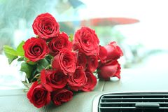 Red roses bouquet on car console Royalty Free Stock Photo