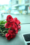 Red roses bouquet on car console Royalty Free Stock Photography
