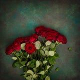Red roses bouquet dark stone background Festive arrangement Stock Photos