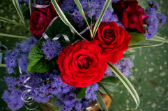 Red roses in the bouquet on the floor stock image