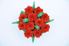 Red roses bouquet made with quiling technique stock image