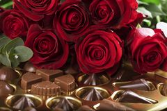 Red Roses and a Box of Chocolates Stock Photography