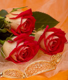 Red roses with bracelet Stock Photography