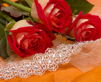 Red roses with bracelet Royalty Free Stock Images