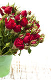 Red roses in bucket Royalty Free Stock Photo