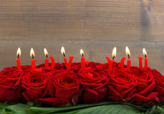 Red roses and burning candles. I love you Royalty Free Stock Image