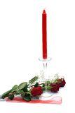 Red Roses with candle. Two Red Roses with candle  isolated on white Royalty Free Stock Photos