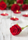 Red roses and candles. Romantic day with red roses and candles, selective focus Royalty Free Stock Photography
