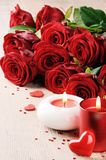 Red roses and candles in St Valentine's setting