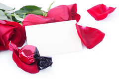 Red roses and candy with a blank gift card Stock Photography