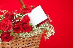 Red roses and card in basket Stock Photos