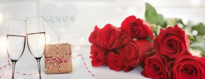 Red roses with champagne and a described heart with love Stock Photography