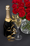 Red roses and champagne. festive decoration Royalty Free Stock Photo