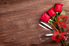 Red roses and champagne glasses Royalty Free Stock Image