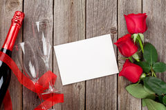 Red roses, champagne and greeting card Stock Images