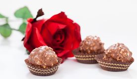 Red roses and chocolate. Valentine red roses and chocolate on white background Royalty Free Stock Photo