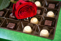 Red roses and chocolates background Stock Photo