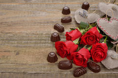 Red roses and chocolates Stock Images