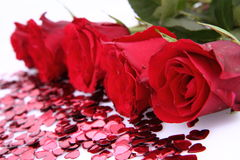 Red roses and confetti Royalty Free Stock Photos
