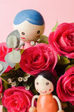 Red roses and couple doll Stock Photos
