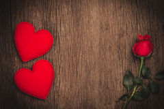 Red roses with decorative hearts Royalty Free Stock Photo