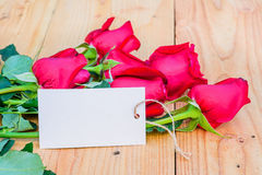 Red roses and empty tag. Red roses and empty tag for your text Stock Images