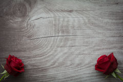 Red roses on empty wooden background. Red roses on background with space for text stock photo