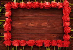 Red roses with empty wooden copyspace Royalty Free Stock Photography
