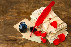 Red roses and feather quill Royalty Free Stock Photo