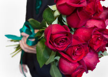 Red roses flower gift. Man is giving red roses bouquet Stock Photo