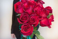 Red roses flower gift. Man is giving red roses bouquet Royalty Free Stock Photos