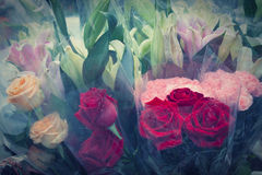 Red roses flowers bouquet in plastic wrap by pastel vintage colo Stock Photo